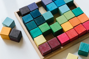 Grimm's blocks on a child's play table.