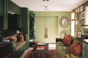 Repurposed creative space with green walls, vintage furniture and bench seating