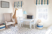 Striped blinds patterned area rug in kids play room.