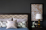 A marble-like pattern is framed above a bedside table