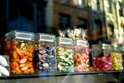 Color-coded confections in glass jars