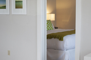A series of photographs hung in a hallway outside a guest room