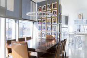 A New York City dining room with a gallery wall of photographs
