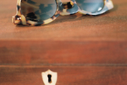 A pair of tortoiseshell sunglasses atop a wooden box