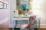 A driftwood mirror hung above a white vanity