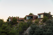Freestanding guest rooms perfectly positioned in a craggy landscape