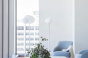 Contemporary white and blue living room with bohemian and modern accents.