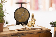 A brass rabbit and vintage scale as party decor.