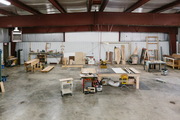 An industrial workspace with a concrete floor.