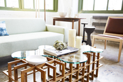 A wood coffee table with contemporary furniture in an industrial loft