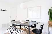 A contemporary dining space with bohemian accents.