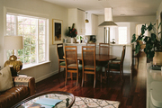 Renovated family style kitchen with cream rug and dining table