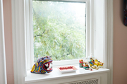 A windowsill with various colorful relics.