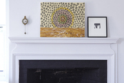 Small art on a white mantel