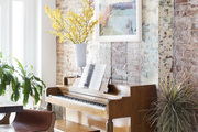 Piano against a rustic brick wall.