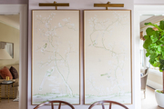 A pair of framed panels of chinoiserie paper