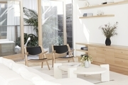 """""""I'm very happy with how the house turned out,"""" says Lunya founder Ashley Merrill. """"That said I don't feel like it's 'done' as generally homes evolve along with me."""" Triptych Coffee Table; Hans Wegner Vintage Chairs."""