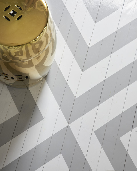 A chevron-pattern painted floor by BHDM design.