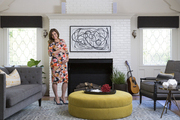 Tiffani Thiessen at home in front of her brick fireplace