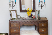 An heirloom vanity flanked by crystal-accented sconces