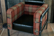 Plaid and leather chair by Heinz Julen