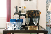 Bar essentials and glassware on a square wooden table
