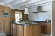 A contemporary kitchen with stainless steel counters and island