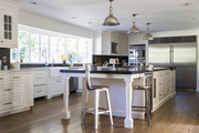 Stainless steel appliances accent a white kitchen