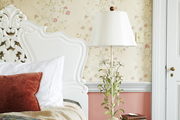 A vintage vignette with floral wallpaper in the background.