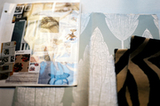 A grouping of inspirational design items and including fabric swatches