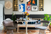 eclectic dining room with round table, gallery wall, and artwork