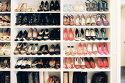 Shoe storage on white built-in shelves