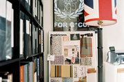 An inspiration board of fabric samples beside a black floor lamp