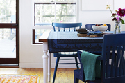 A kitchen table with blue accents