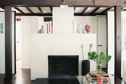 A streamlined mantel decorated with books and art objects
