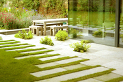 Wooden outdoor furniture on a stone patio