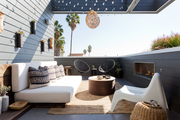A contemporary outdoor space with white seating and neutral decor.