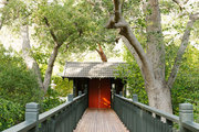 A suspended walkway meanders through the trees at the Golden Door Spa