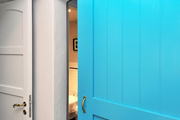 A detail of a turquoise blue door.