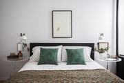 Matching lucite side tables in a Brooklyn master bedroom
