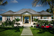 A Harbour Island home painted blush pink in the traditional Bahamian style