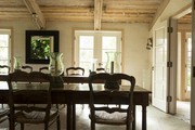 A light-filled dining room with exposed beams