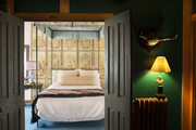 Four-poster bed in front of an antique screen