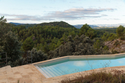 A geometric pool overlooking miles of unobstructed forest