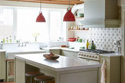 Exposed beams hover over a kitchen island