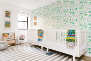 A modern, bright nursery for twins.