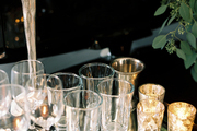 Barware and glasses in a mirrored tray