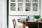 A china cabinet provides storage in a dining area