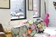 An antique elephant next to interesting objets at Buckingham Interiors + Design's Chicago showroom