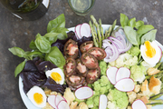A detail of a seasonal salad with an assortment of ingredients.